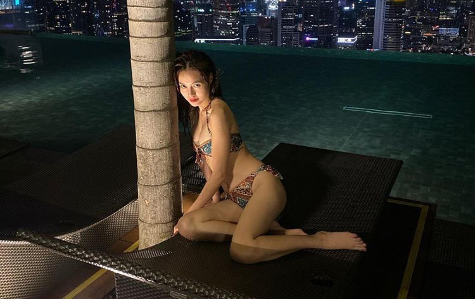 Kín đáo là thế nhưng mỗi lần Ninh Dương lan Ngọc thả dáng với bikini khiến fan 'hoa mày chóng mặt' - Ảnh 2