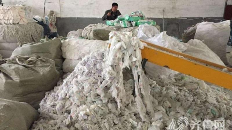 Kinh hoàng: Khui đường dây sản xuất bỉm người lớn từ bỉm dùng rồi - Ảnh 1