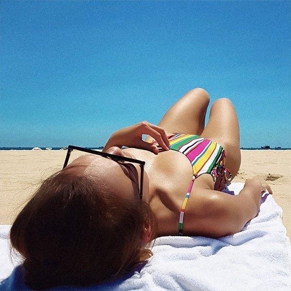 Những nàng da nâu mặc bikini chuẩn Tây của showbiz Việt - Ảnh 9
