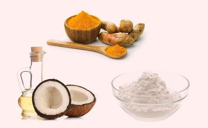 Các nguyên liệu làm trắng răng bằng nghệ và dầu dừa.