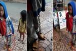 Nghi vấn bé trai bị cha ruột xích chân tay, đi lang thang khắp chợ cùng em gái khiến dư luận phẫn nộ