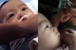Nghẹn ngào khoảnh khắc cậu bé 5 tháng tuổi bị bỏ rơi bên đường nắm chặt tay cảnh sát không buông