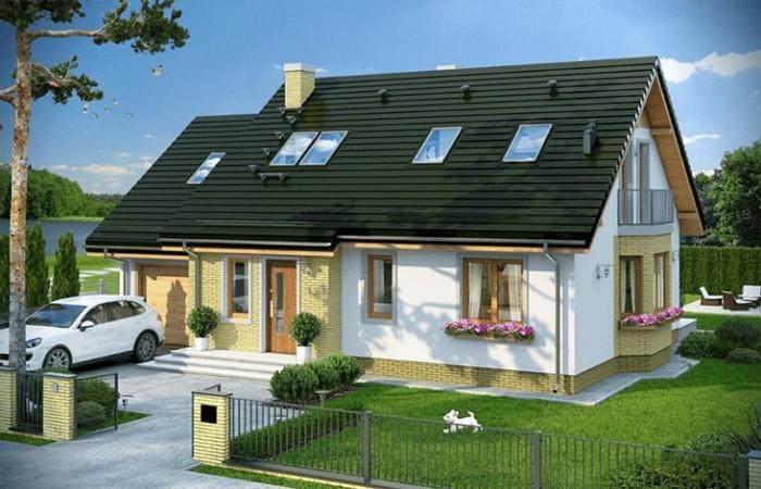 Nhà cấp 4 có gara nổi bật với mái thái màu xanh lục. Xung quanh bố trí cây cảnh giúp ngôi nhà thêm sinh động. Ảnh: Printest.