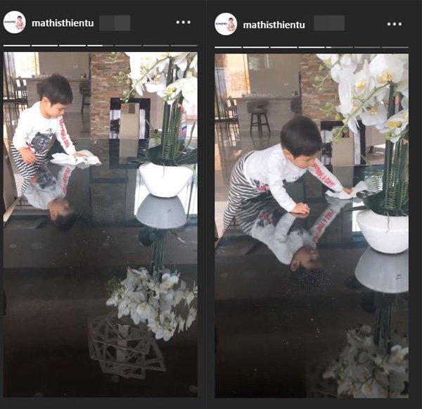 Thủy Tiên dạy con trai lau bàn khi cậu bé làm bẩn bàn ghế