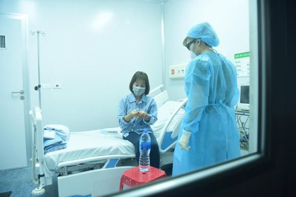 Tất cả người nhiễm virus corona đều được điều trị miễn phí - Ảnh 1