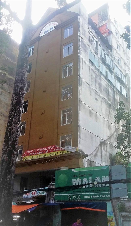 Cao ốc xây trái phép giữa trung tâm thành phố, gần 10 năm vẫn chỉ xử lý trên... giấy - Ảnh 1