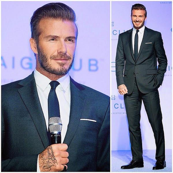 Khi xuất hiện tại Hà Nội Beckham trung thành với vest hai cúc cổ ve nhỏ, toát lên vẻ lịch lãm thời thượng trong bộ suit Ralph Lauren Back Label