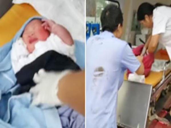 Em bé được các bác sĩ sơ cứu trước khi đưa vào bệnh viện chăm sóc