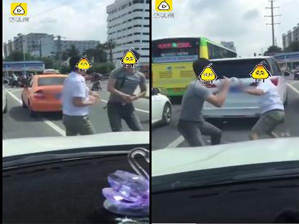Hai người đàn ông đánh nhau trên đường phố sau va chạm.