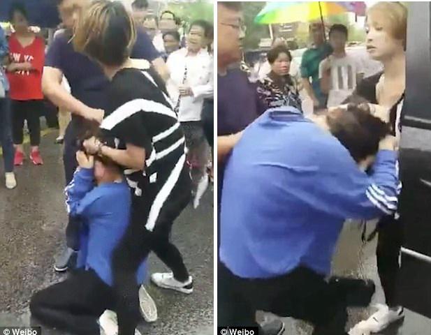Cặp kè với ông chủ, bồ nhí bị vợ túm tóc đánh ghen dã man giữa đường - Ảnh 1