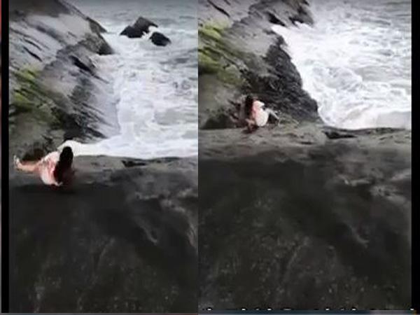 Đứng tim clip cô gái bị trượt chân rơi xuống biển dung nham đỏ rực - Ảnh 3