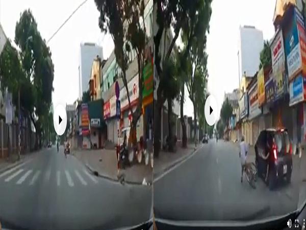 Mở cửa ô tô thiếu quan sát, người phụ nữ khiến cụ ông đi xe đạp ngã nhào - Ảnh 1
