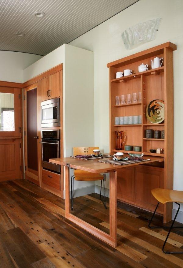 Bàn ăn đa năng kèm tủ này được thiết kế khá ấn tượng với hệ thống bàn gấp vào phần phía dưới của tủ gắn tường. Với một phần bắt vào tường được thiết kế dạng hộc để đồ và phần còn lại có thể kéo ra để tạo thành một chiếc bàn ăn tiện nghi chính là giải pháp hoàn hảo nhất cho những căn phòng bếp chật hẹp. Khi gia đình dùng bữa xong có thể gấp gọn vào tường như một chiếc tủ đựng đồ.