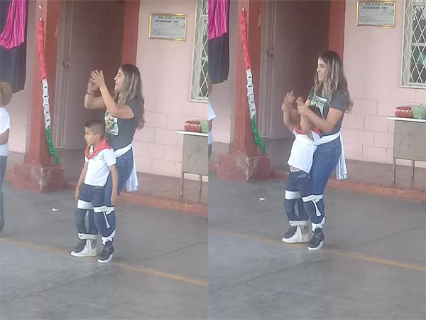 Cô giáo buộc cậu học sinh vào người tham gia nhảy cùng các bạn