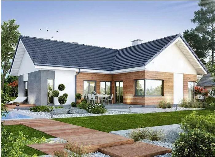 Kiến trúc của ngôi nhà là sự kết hợp giữa hệ mái dốc truyền thống cùng cách sử dụng vật liệu theo xu hướng hiện đại với tông màu đen – trắng chủ đạo. Ảnh: Kienphucgia.