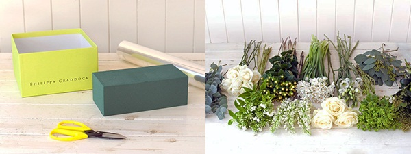 Một hộp giấy nhỏ cứng cáp, giấy bóng kính, kéo, hoa hồng trắng, xốp cắm hoa và các loại cành lá hoa lớn nhỏ khác nhau là những thứ bạn cần chuẩn bị trước khi cắm hoa