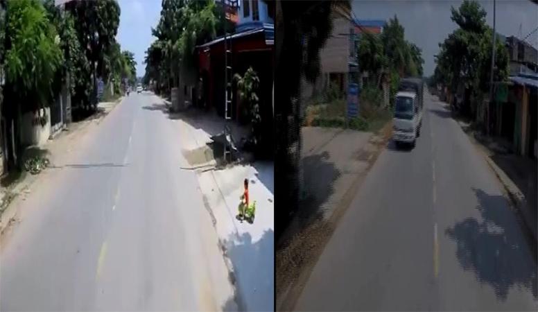 Tài xế ô tô thót tim vì bégái bất ngờ lái xe đồ chơi lao ra đường - Ảnh 1