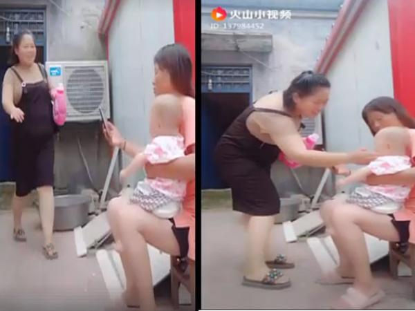 Xôn xao clip người phụ nữ bắt cóc em bé ngay trên tay mẹ - Ảnh 1
