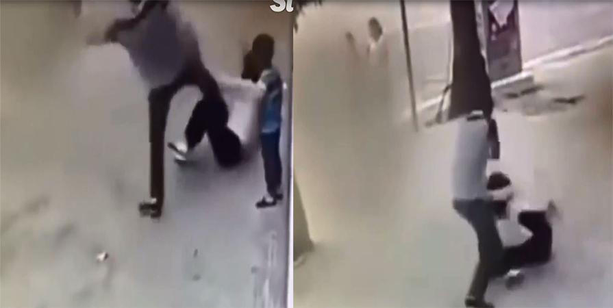 Cậu bé ra sức ngăn cản khi thấy bố đánh mẹ trên đường - Ảnh 1