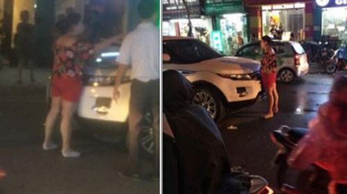 Hà Nội: Vợ ôm con chặn cửa xe ô tô đánh ghen, bồ nhí quáng quàng tháo chạy - Ảnh 1