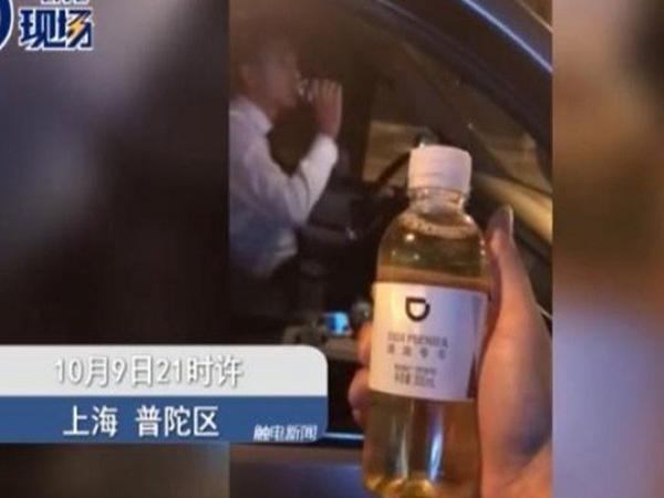 Hành khách uống nhầm chai nước tiểu của tài xế Didi