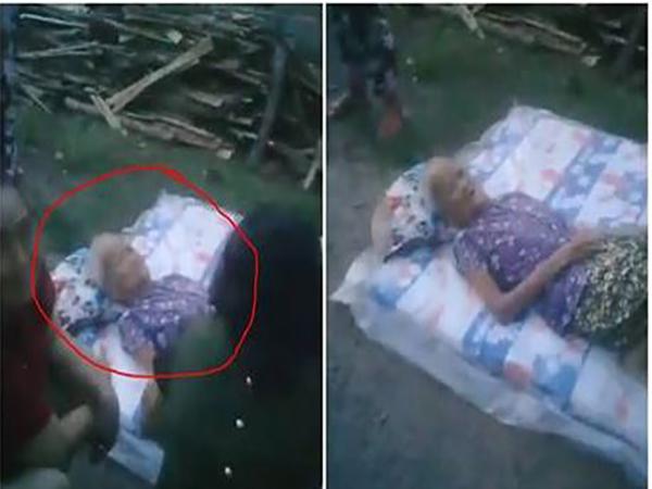 Cụ bà được đặt trên tấm nệm và vứt ra đường.