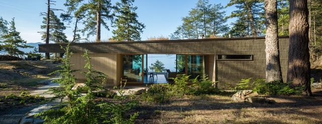 Nhà hình học nằm ở phần lõm của sườn đồi với vườn cây trên mái - Ảnh 4