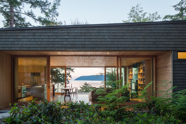 Nhà hình học nằm ở phần lõm của sườn đồi với vườn cây trên mái - Ảnh 10