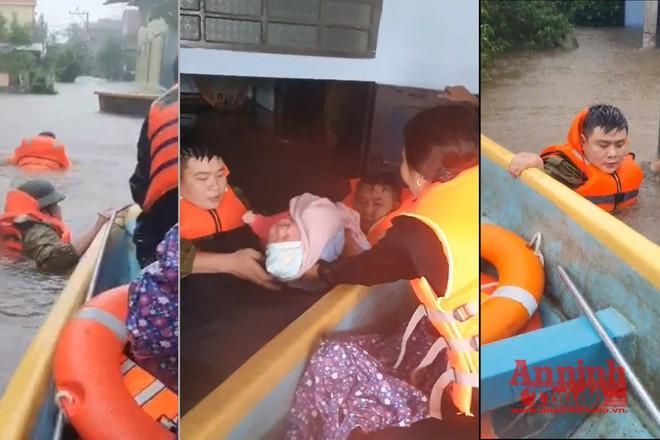 Xúc động hình ảnh Công an xã lội nước sâu đẩy xuồng cứu cháu bé sơ sinh khỏi lũ dữ - Ảnh 1