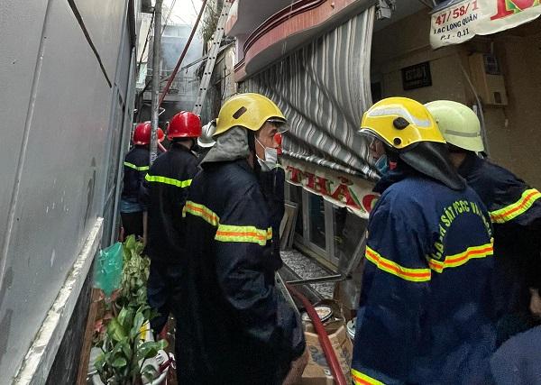Hai ngày sau vụ cháy 8 người chết ở TPHCM: Tang thương bao phủ khu dân cư - Ảnh 3