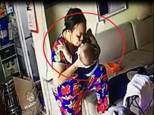 Người phụ nữ giúp việc nhổ thẳng nước bọt vào mặt bé trai