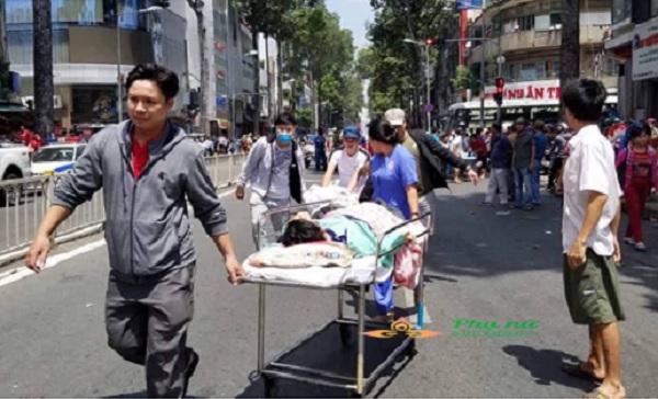 Giải cứu 28 người khỏi đám cháy kí túc xá ở trung tâm Sài Gòn - Ảnh 1