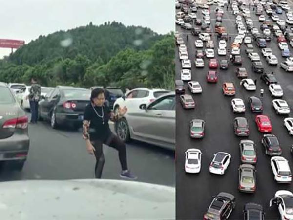 Tắt đường nghiêm trọng, người phụ nữ bước xuống xe tập Thái cực quyền