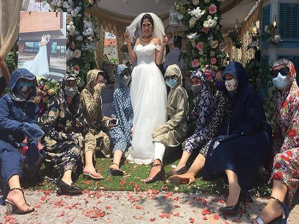 Chết cười với hình ảnh 'hội chị em' mặc áo chống nắng kín mít đi ăn cưới - Ảnh 1