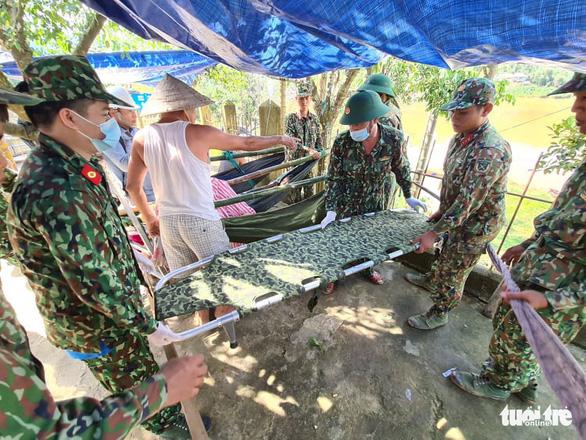 NÓNG: Những hình ảnh đầu tiên của nạn nhân vụ sạt lở ở Trà Leng - Ảnh 5