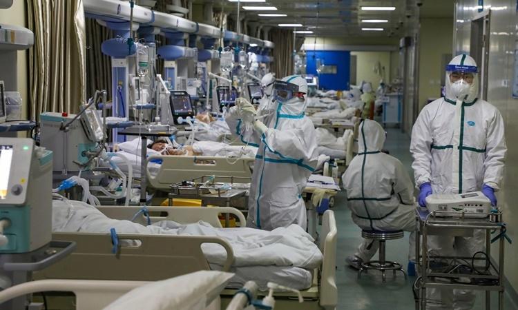 Số người chết vì virus corona tăng lên 910 - Ảnh 1